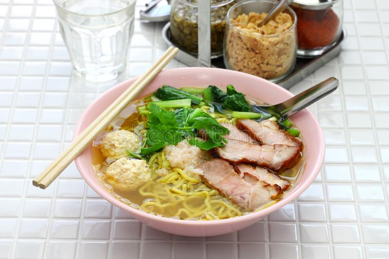 Bami nam, egg noodles soup served with roast pork royalty free stock photography