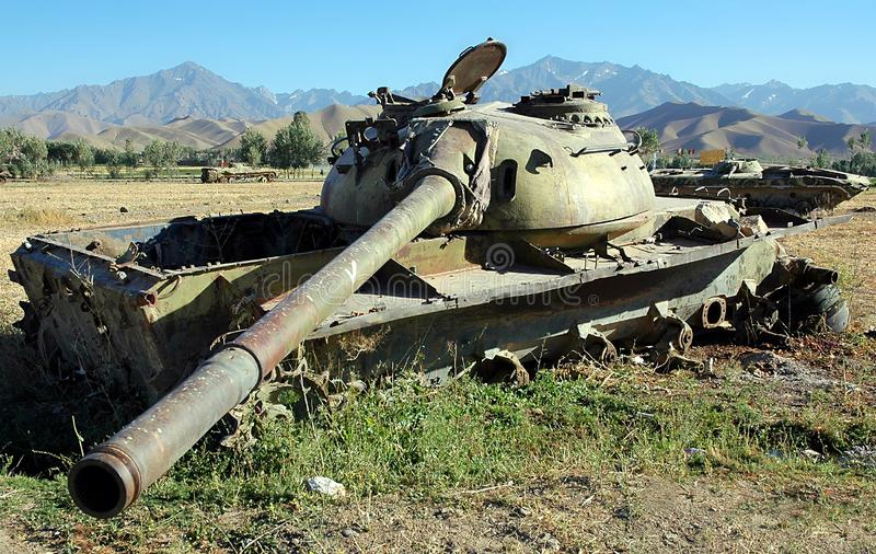 Destroyed tanks near Bamiyan, Afghanistan. Bamyan Bamiyan, Central Afghanistan. Destroyed tanks in a field - a reminder of the Afghanistan war. There are many stock image