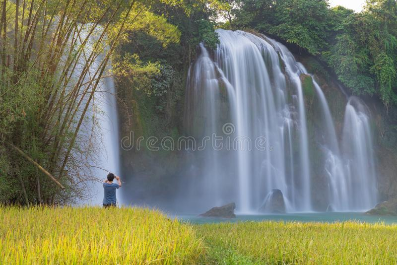 Ban Gioc waterfall with rice field in harvest time in Cao Bang, Vietnam.  stock photography