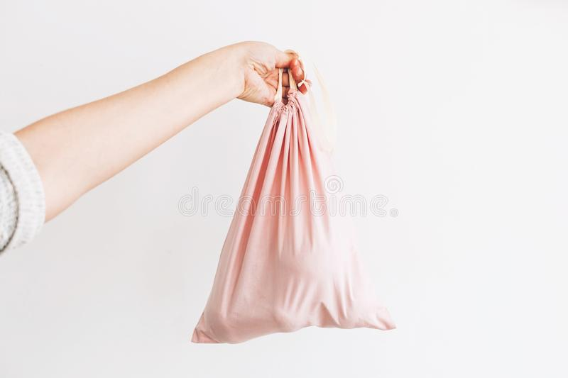 Ban single use plastic. Woman holding in hand groceries in reusable eco bag. Zero Waste shopping concept. Choose eco friendly stock images