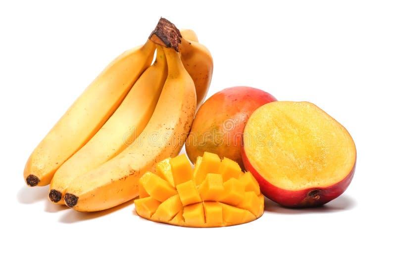 Banaan en mango met de gesneden helft royalty-vrije stock foto's