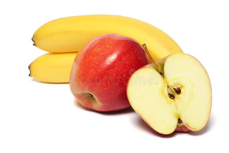 Banaan met rode appel op wit royalty-vrije stock foto
