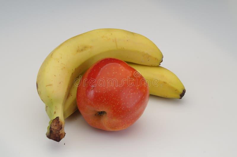 Banan и яблоко стоковые фотографии rf