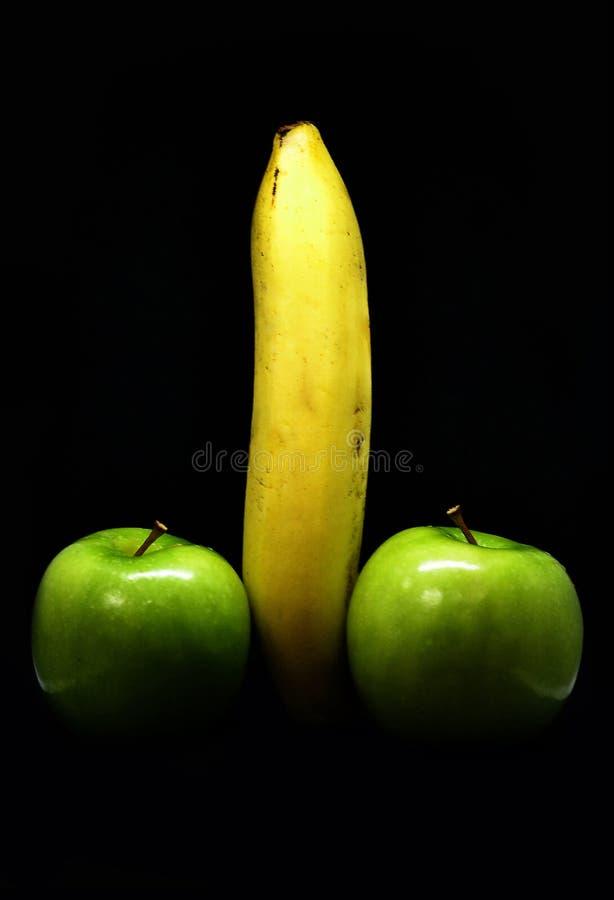 Banan med äpplen arkivbild