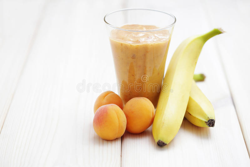 Banana and apricot shake stock photos