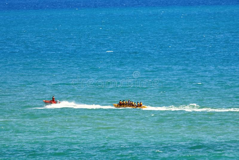 Banana Boat Full of Tourists Speeding Away stock photography