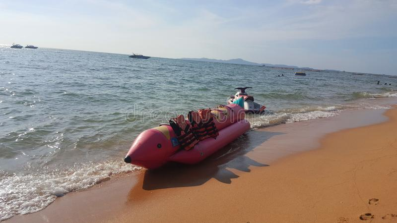 Banana boat lay on the beach, Holiday in Pattaya, Thailand royalty free stock images