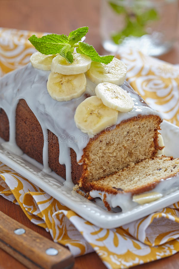 Banana bread. With chocolate chips on wooden table stock photos