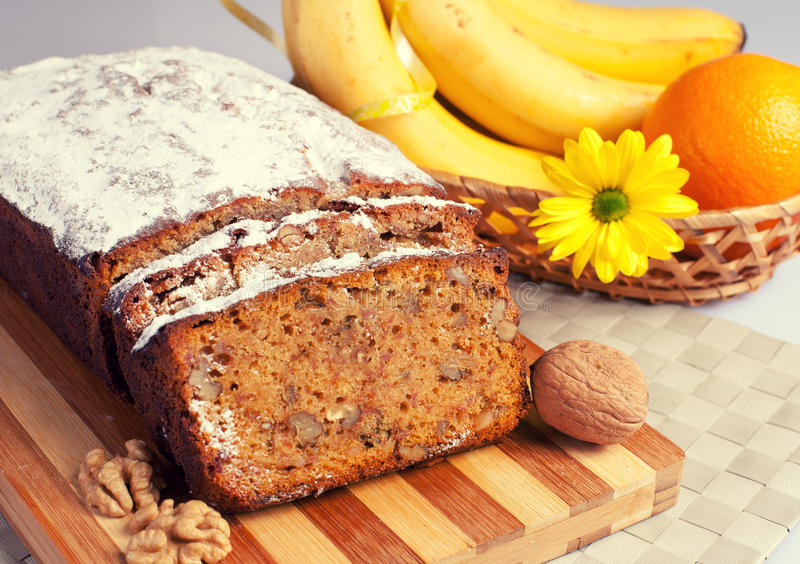 Banana bread. Decorated with nuts, fruit and flower royalty free stock photos
