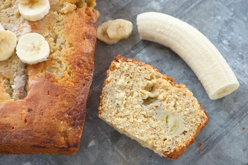 Banana bread. Homemade banana bread and fresh fruit royalty free stock photo