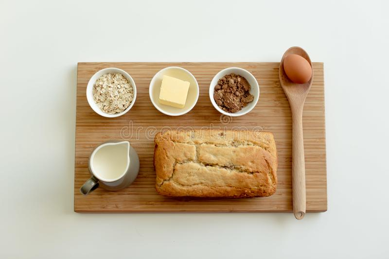 Banana bread with ingredients on wooden board stock image