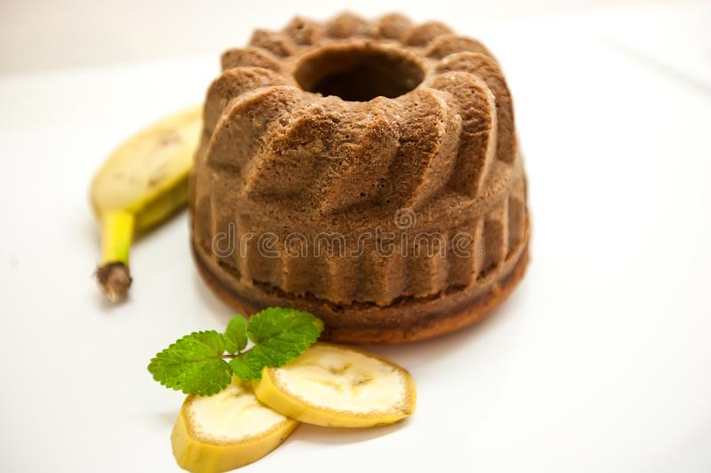 Banana Bundt Cakes on a Plate with Bananas stock photo