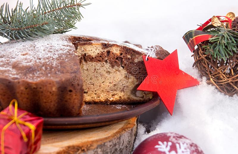 Banana cake bread traditional pie on snow surfase for Christmas royalty free stock photography