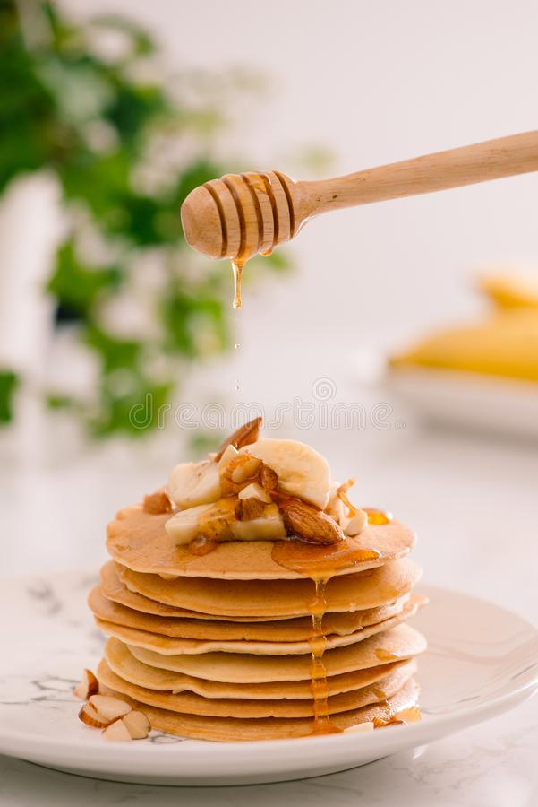 Banana cashew pancakes with bananas and caramel sauce. Banana cashew pancakes with bananas and caramel sauce stock images