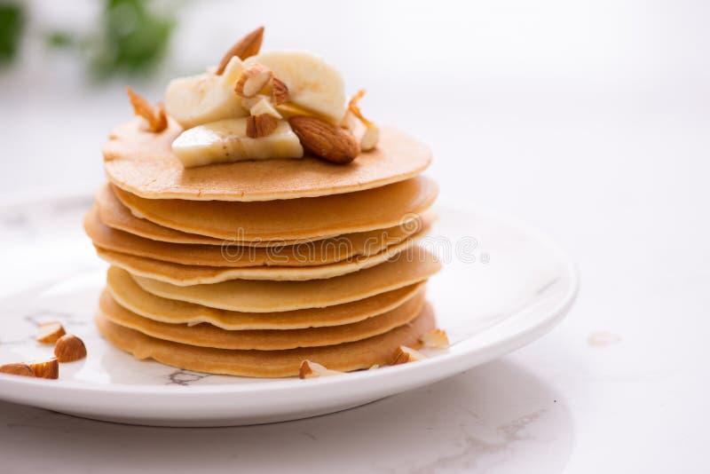 Banana cashew pancakes with bananas and caramel sauce. Banana cashew pancakes with bananas and caramel sauce stock photos