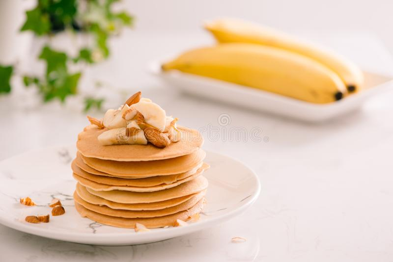Banana cashew pancakes with bananas and caramel sauce. Banana cashew pancakes with bananas and caramel sauce royalty free stock images