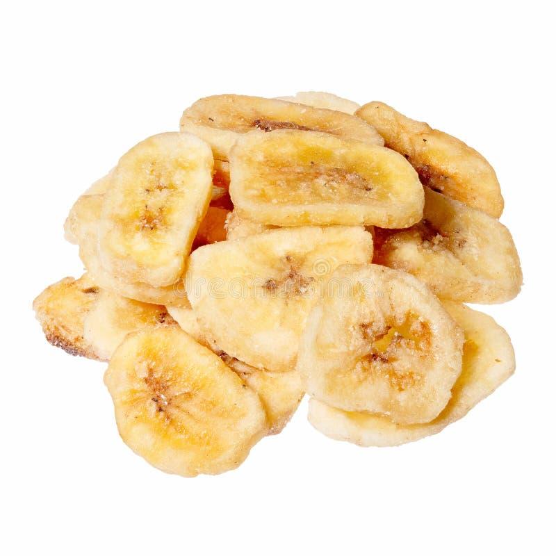 Banana chips isolated on white, close up. Banana chips isolated on white. High resolution photo stock photos
