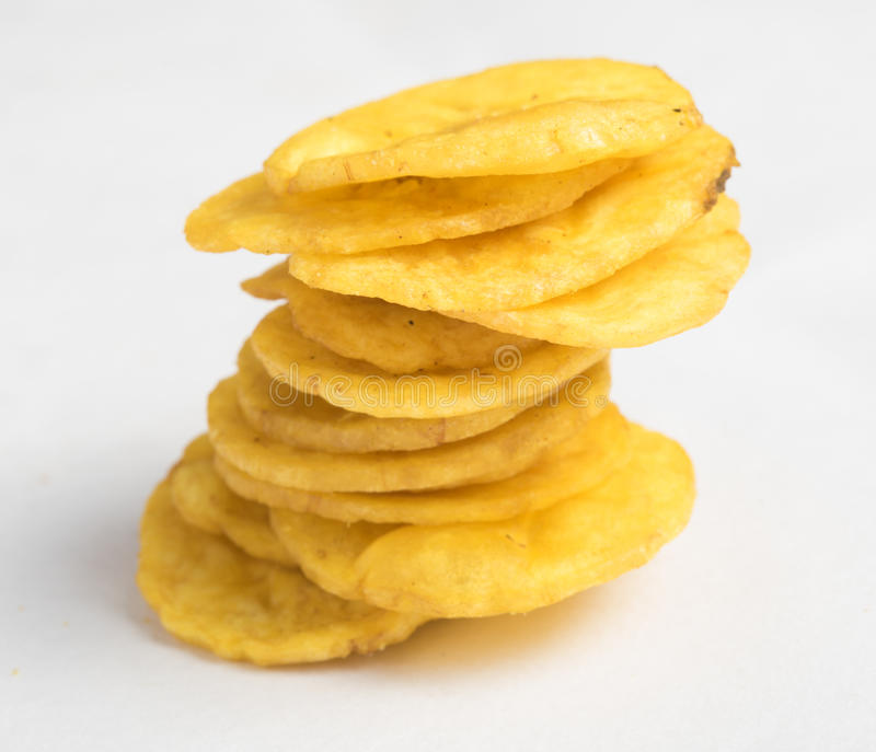 Banana chips on white background. Banana chips on the white background royalty free stock photography