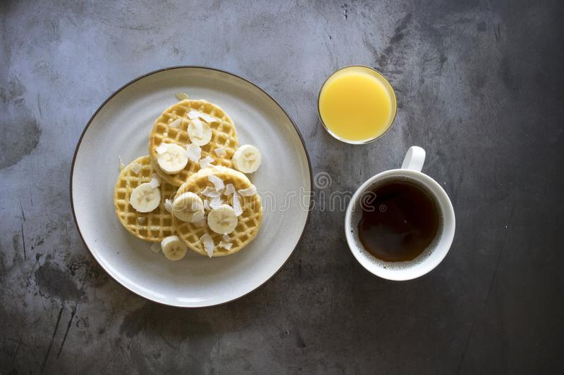 Banana Coconut Waffles with Syrup stock images
