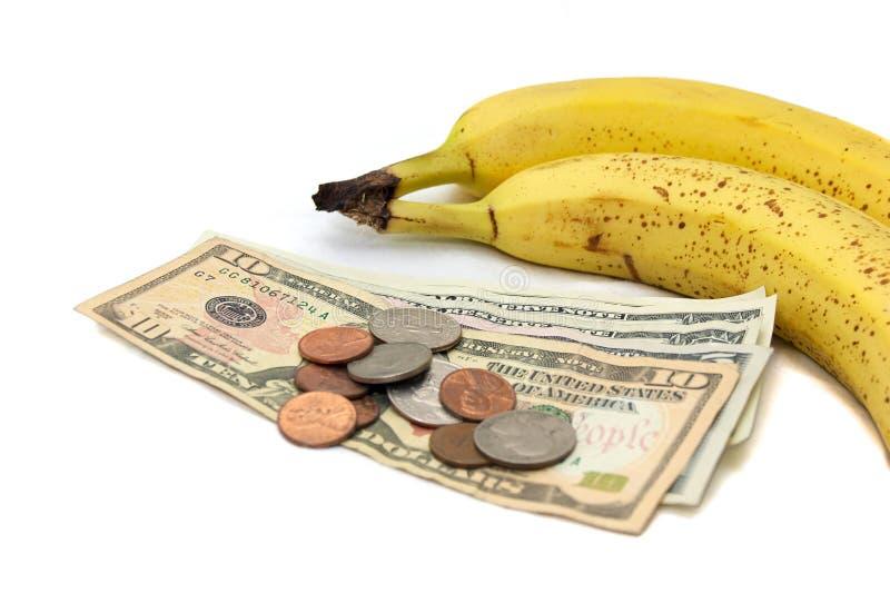 Banana com dinheiro imagens de stock