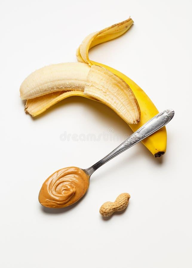 Banana com manteiga de amendoim imagem de stock