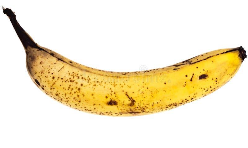 Banana com pontos marrons imagens de stock royalty free