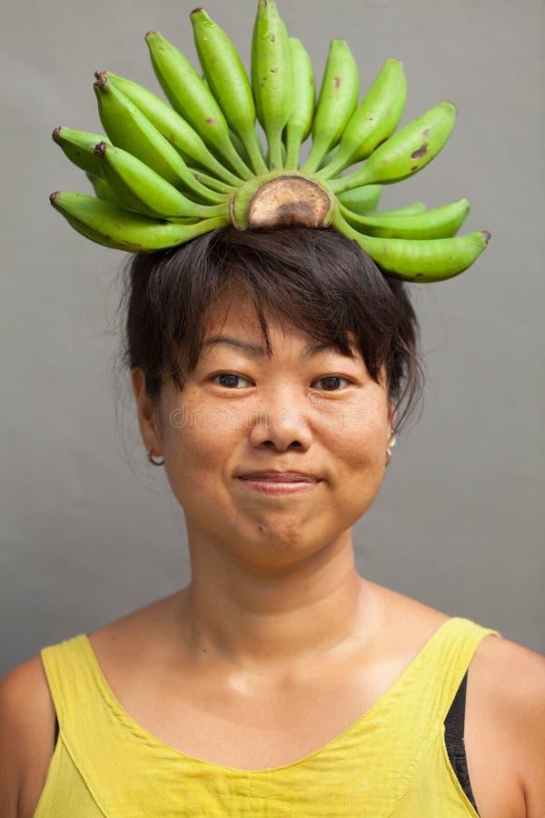 Banana della donna fotografia stock
