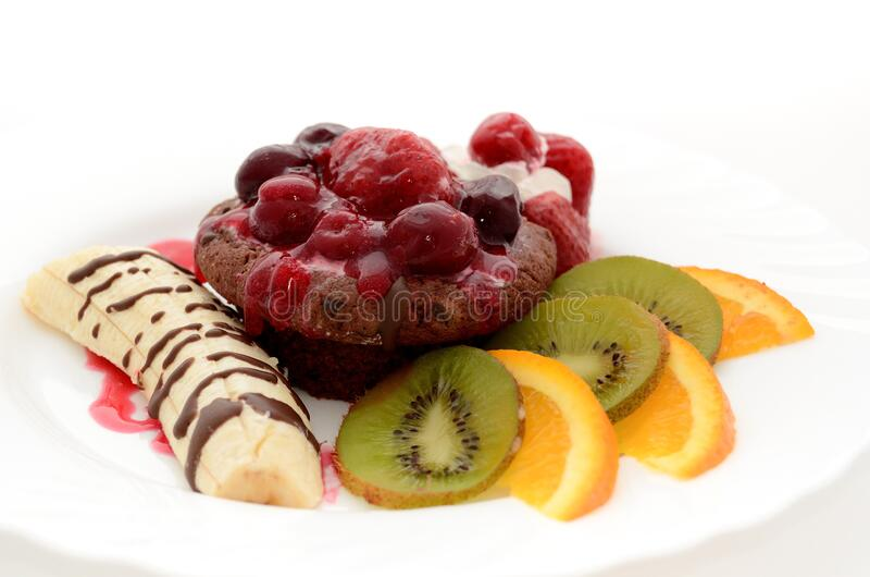 Banana Drizzled With Chocolate Syrup Beside Chocolate Cupcake With Raspberry And Kiwi And Orange Slices On The Side On White Plate Free Public Domain Cc0 Image