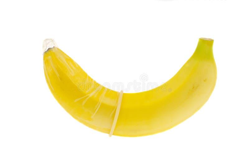 Banana em um preservativo foto de stock royalty free
