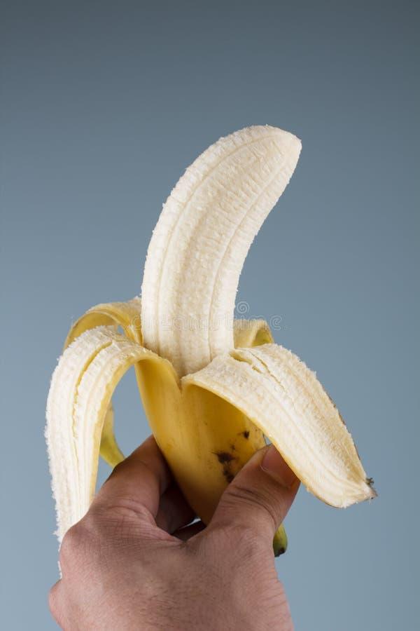 Banana fora descascada imagem de stock royalty free