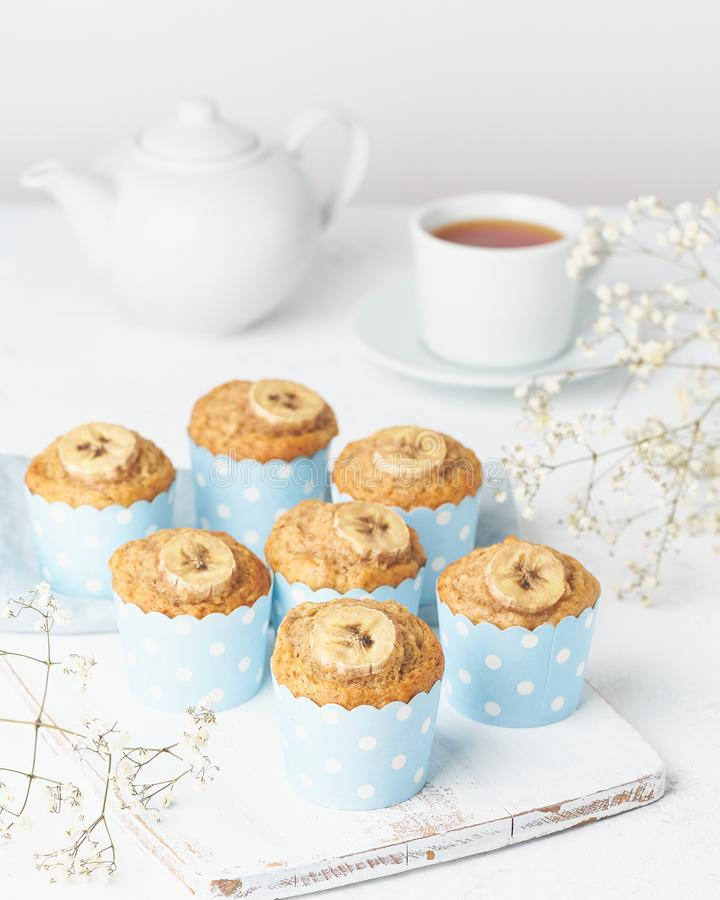 Free Banana Muffin, Cupcakes In Blue Cake Cases Paper, Side View, Vertical, White Concrete Table Stock Image - 149428961