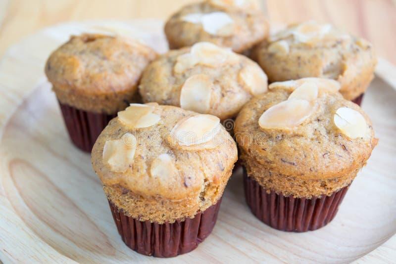 Banana muffins and almond slice stock image