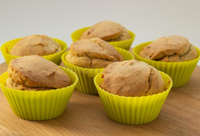 Banana muffins on a wooden board, natural light, close-up stock photography