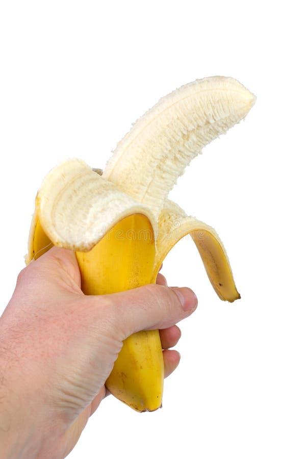 Banana nella mano su fondo bianco fotografie stock