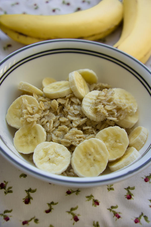 Banana oatmeal served on a table stock image