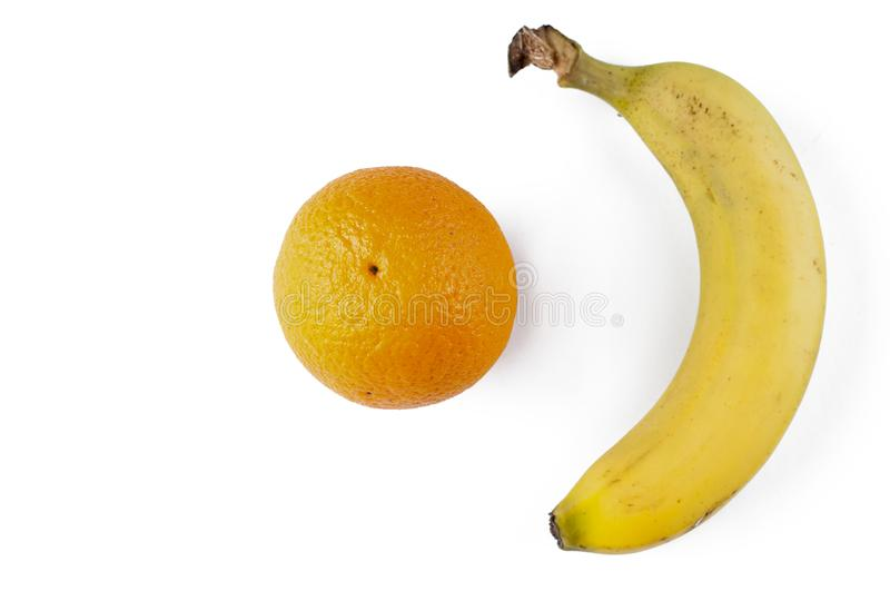 Banana and oranges isolated on a white background. Tropical fruit royalty free stock image
