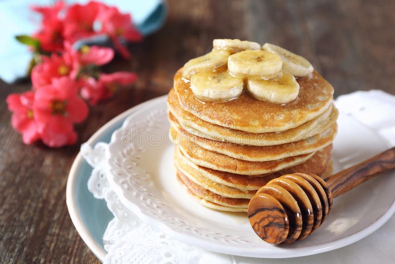 Banana pancakes with honey and caramelized bananas stock photo