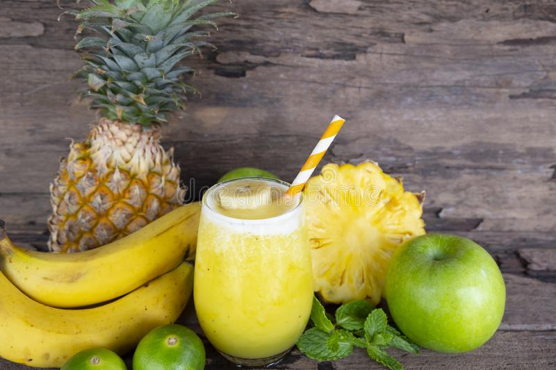 Banana with pineapple and apples, smoothies yellow fruit juice healthy drink. Banana with pineapple and apples, smoothies yellow fruit juice healthy drink royalty free stock image