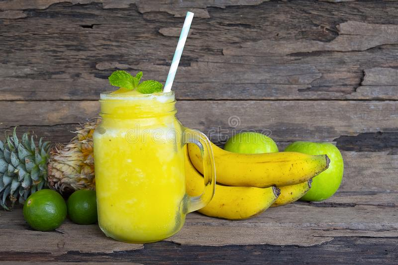 Banana with pineapple and apples smoothies yellow fruit juice healthy drink . Banana with pineapple and apples smoothies yellow fruit juice healthy drink stock photos