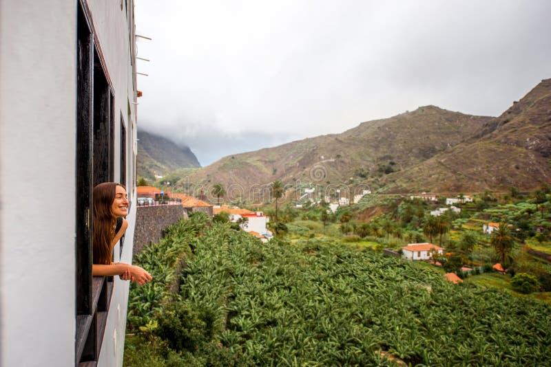 Banana plantations on La gomera island. Woman looking from the window on banana plantation near Hermigua village on La Gomera island in Spain stock images