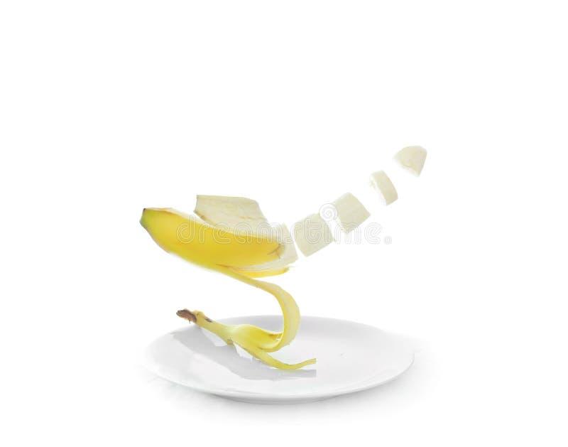 Banana que flutua acima da placa fotos de stock