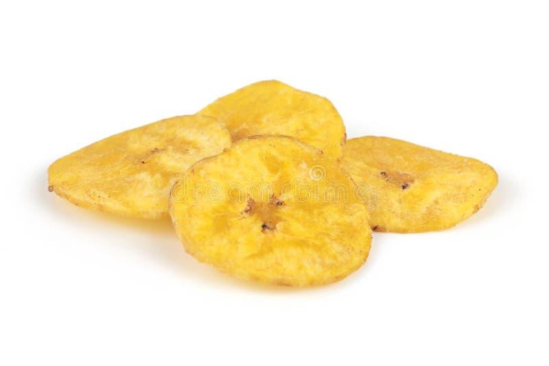 Banana. Several banana chips isolated on white background royalty free stock image