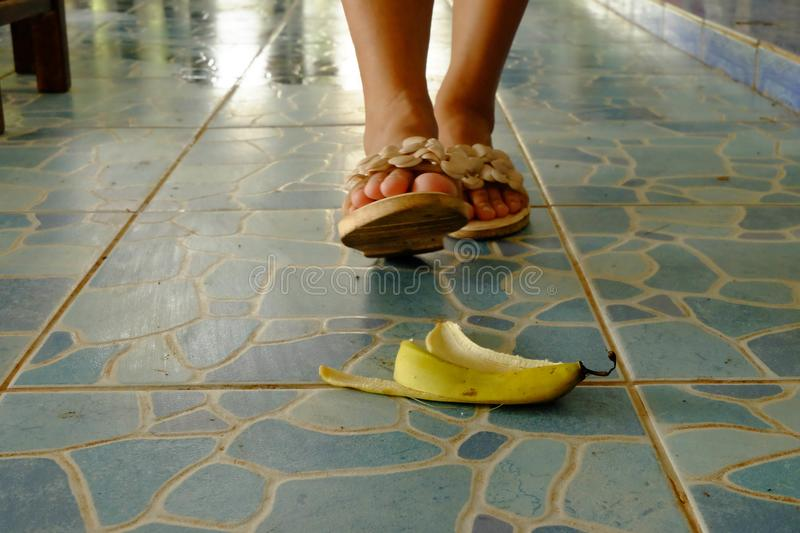 The banana skin lies on a walkway. Watch out for the banana skin lies on a walkway royalty free stock photo
