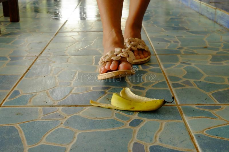 Watch out for the banana skin lies on a walkway. The banana skin lies on a walkway stock photo