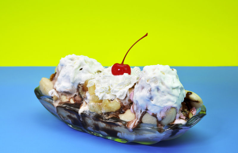 Banana Split. Isolated on blue and yellow background royalty free stock images