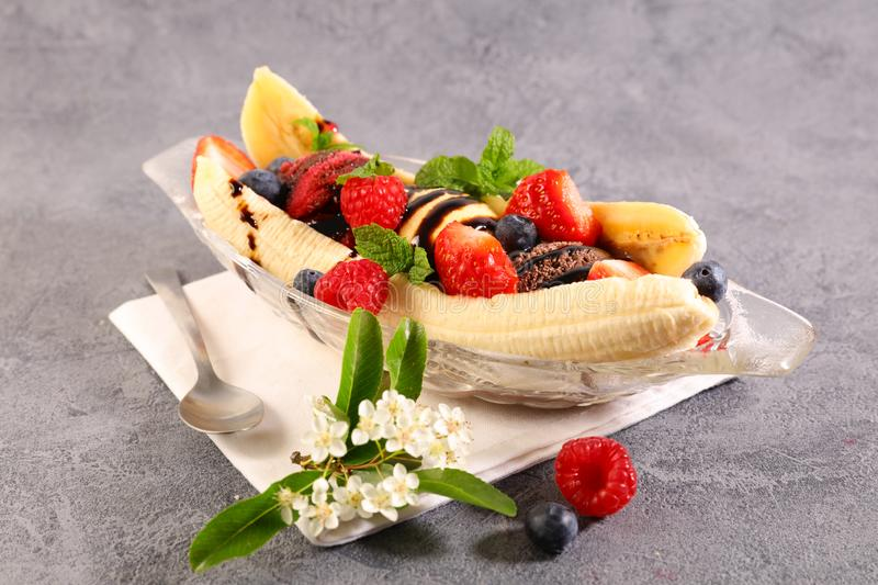Banana split. Banana with ice cream and fruits stock images