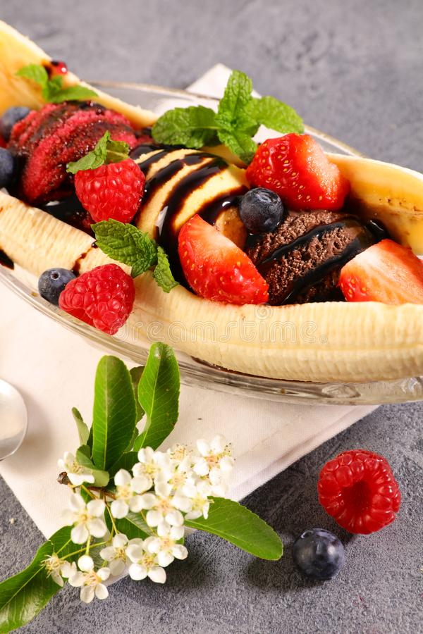 Banana split. Banana with ice cream and fruits royalty free stock photography