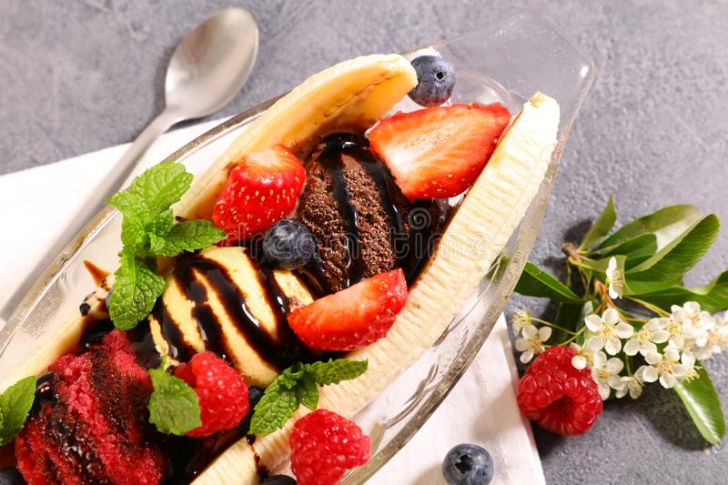 Banana split. Banana with ice cream and fruits stock photography