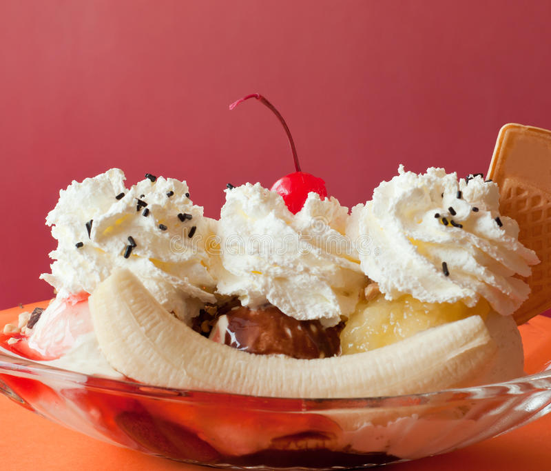Banana split ice cream. On the restaurant table stock photography