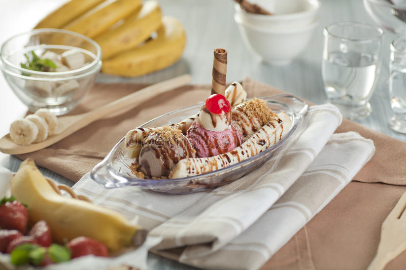 Banana Split. Made with scoops of vanilla, chocolate and strawberry ice cream served in a row between the split banana. In no particular order, pineapple royalty free stock image